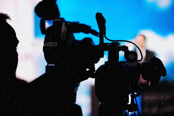 Cameraman Recording Speaker At Media Press Conference - Stock Photo - Images