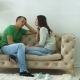 Relaxed Couple Talking Together Sitting on Sofa - VideoHive Item for Sale