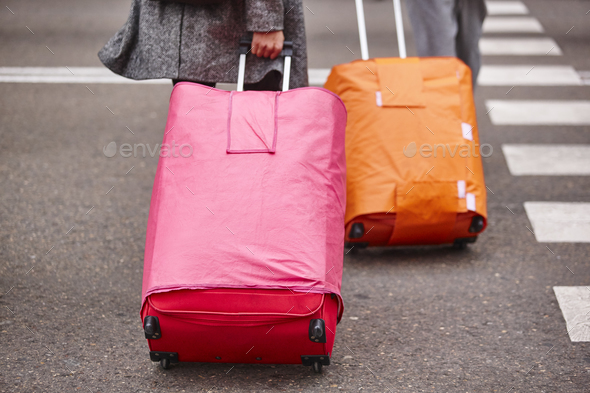 People croosing the street with baggage. Travel tourism background. Horizontal - Stock Photo - Images