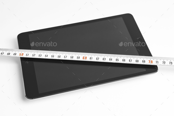 Tablet and tape measure. Isolated on white. Construction design. Horizontal   - Stock Photo - Images