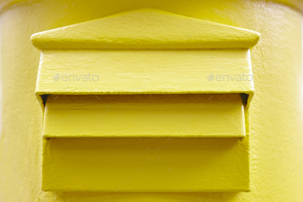 Classic yellow mail box detail. Postbox. Postal service. Traditional communication - Stock Photo - Images