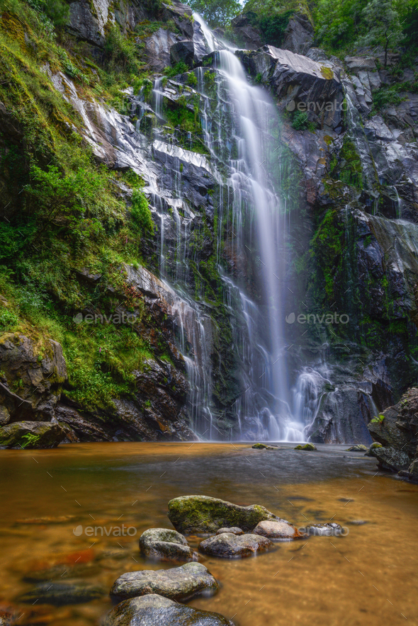 Spectacular waterfall on a rocky cliff - Stock Photo - Images