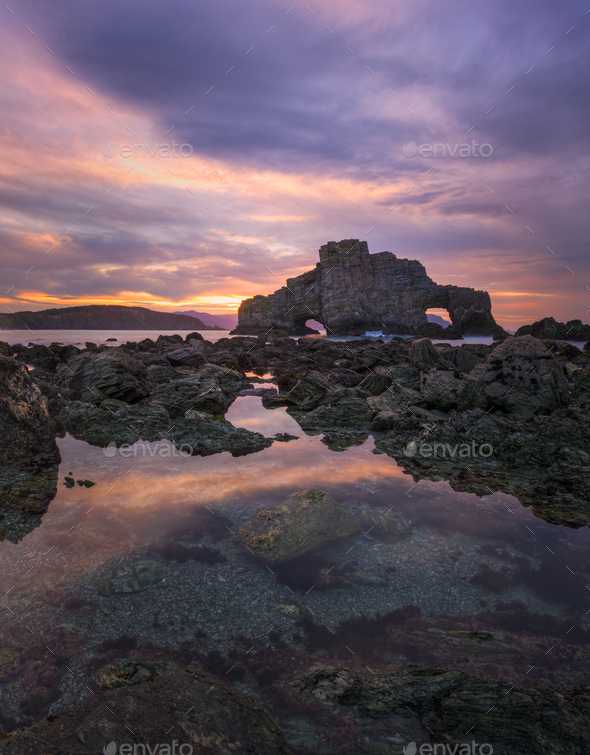 Sunset at low tide in front of the Penafurada in Loiba - Stock Photo - Images