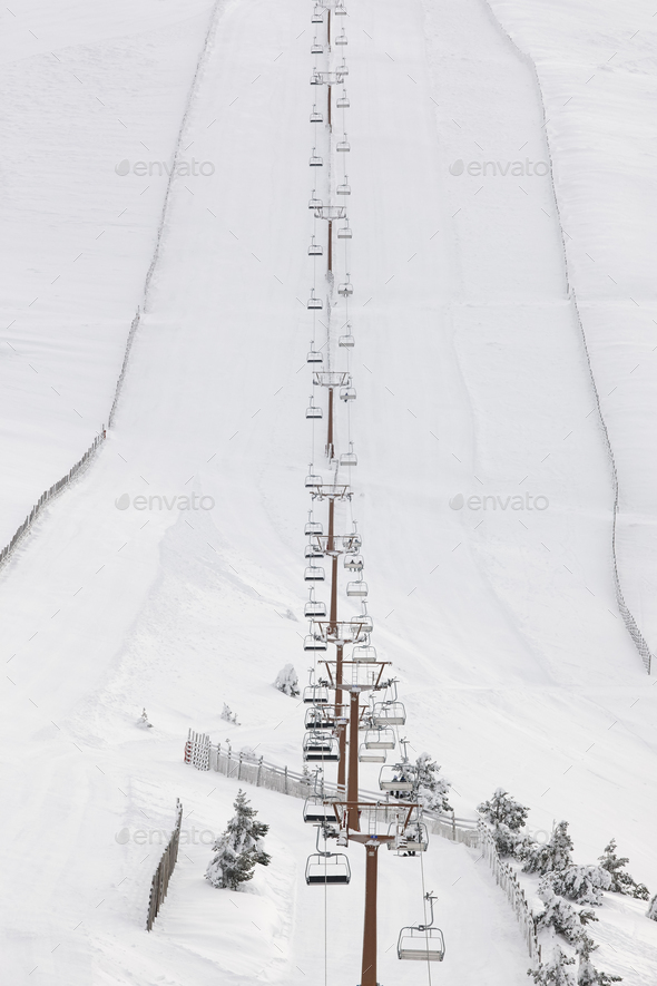 Ski lift and slope on a snow landscape. Winter sport - Stock Photo - Images