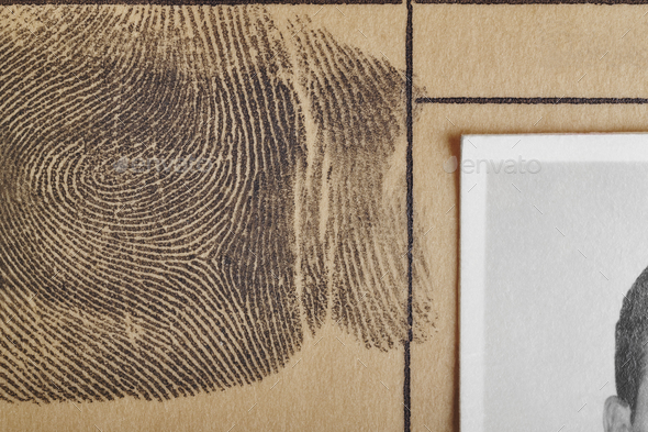 Digital ink fingerprint over a textured paper. Security control. Vertical - Stock Photo - Images