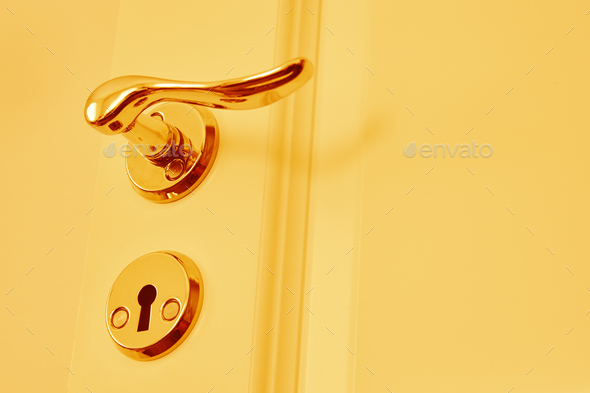 Metallic classic door knob in warm tone. Open closed. Horizontal - Stock Photo - Images