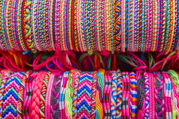 Colorful wristbands. Fabric textured background. Hand made. Horizontal - Stock Photo - Images