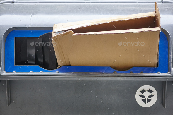 Cardboard paper waist on a plastic container. Recycle. Ecology. Horizontal - Stock Photo - Images