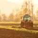Farmer plowing soil at sunset in spring season - PhotoDune Item for Sale