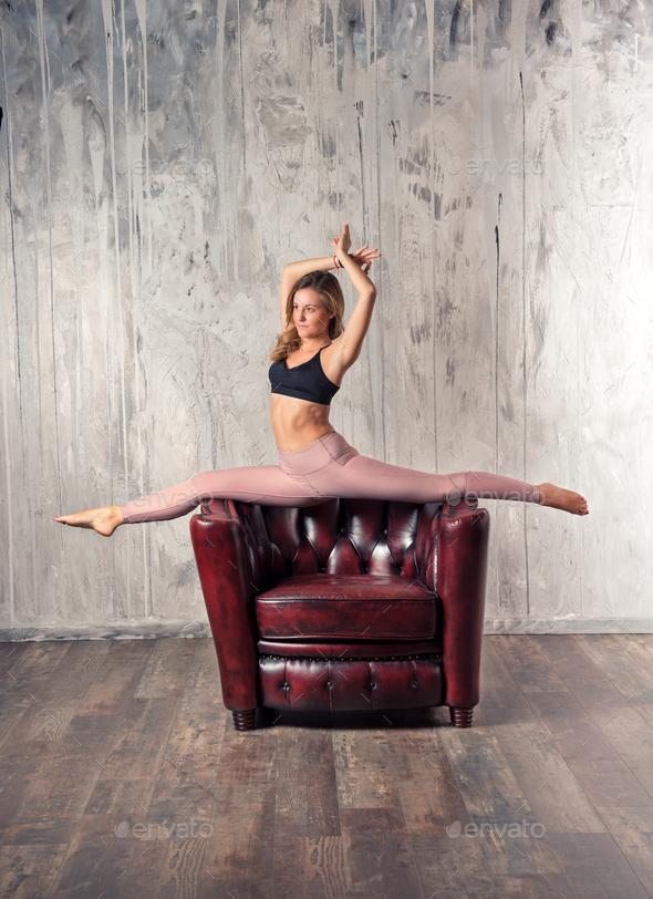 Young fit woman doing hanumanasana yoga pose - Stock Photo - Images