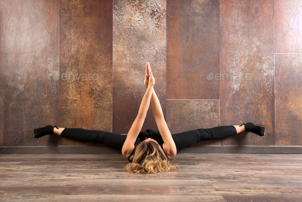 Fit woman exercising yoga on wooden floor - Stock Photo - Images
