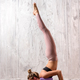 Young fit woman doing salabhasana yoga pose - PhotoDune Item for Sale