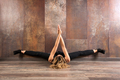 Fit woman exercising yoga on wooden floor - PhotoDune Item for Sale