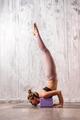 Young fit woman doing salabhasana yoga pose - PhotoDune Item for Sale