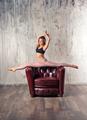 Young fit woman doing hanumanasana yoga pose - PhotoDune Item for Sale