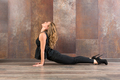 Fit woman doing bhujanasana yoga pose - PhotoDune Item for Sale
