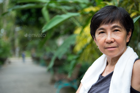 Senior Asian woman in park - Stock Photo - Images