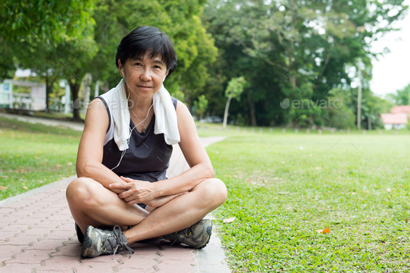 Senior woman resting after jogging - Stock Photo - Images