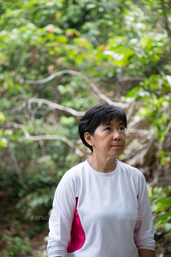 Asian woman hiking in jungle - Stock Photo - Images