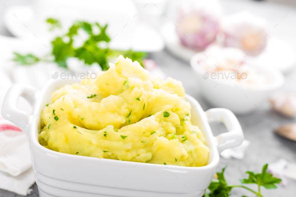 Mashed potato. Potato mash with garlic and parsley. Boiled potato. Potato puree - Stock Photo - Images