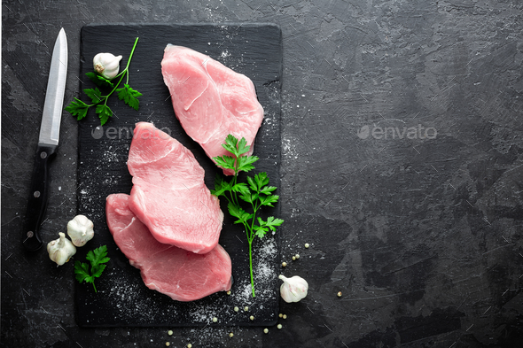 Raw turkey meat. Fresh turkey meat steakes sliced - Stock Photo - Images