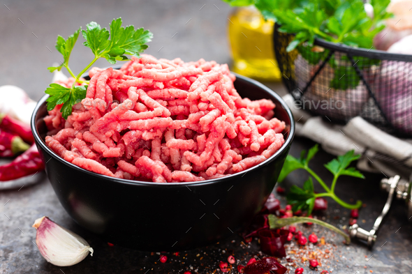Raw ground beef meat with ingredients for cooking. Fresh minced meat - Stock Photo - Images