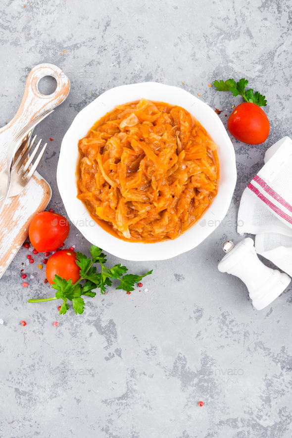 Cabbage stew. Cabbage braised in tomato sauce - Stock Photo - Images
