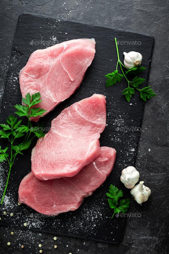 Raw turkey meat. Fresh turkey meat steakes sliced - Stock Photo - Images
