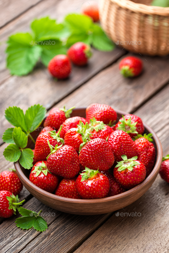 Strawberry. Fresh strawberry with leaves on wooden table - Stock Photo - Images
