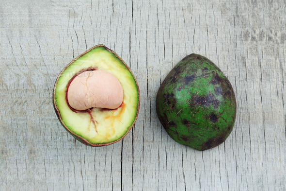 Avocado of half on wooden - Stock Photo - Images