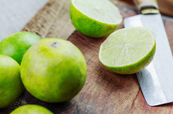 Fresh lime cut and knife on wooden - Stock Photo - Images