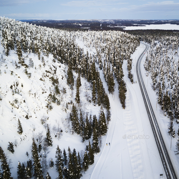 Aerial view of a winter road. Winter landscape countryside. Aerial photography of snow forest.  - Stock Photo - Images