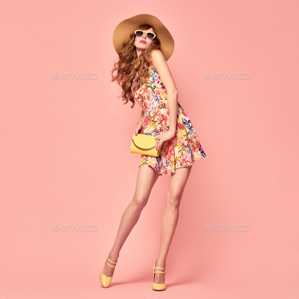 Playful Summer Lady. Floral Dress,Heels. Hairstyle - Stock Photo - Images