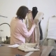 Woman Tailor Takes Measurements on Fabric on Mannequin in Atelier. - VideoHive Item for Sale