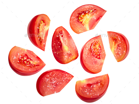 Tomato chunks halved slices salted - Stock Photo - Images