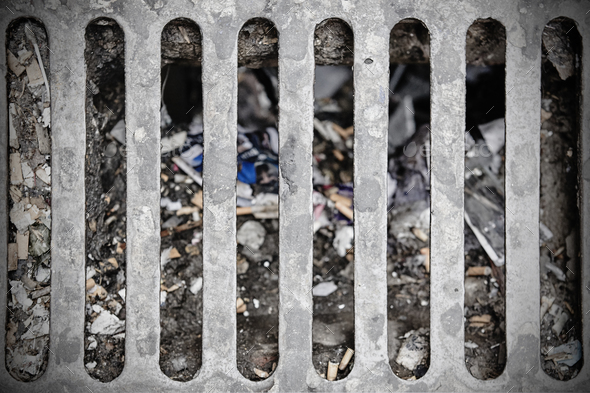 Dirty sewer on a street. Urban pollution. Grunge drain  - Stock Photo - Images