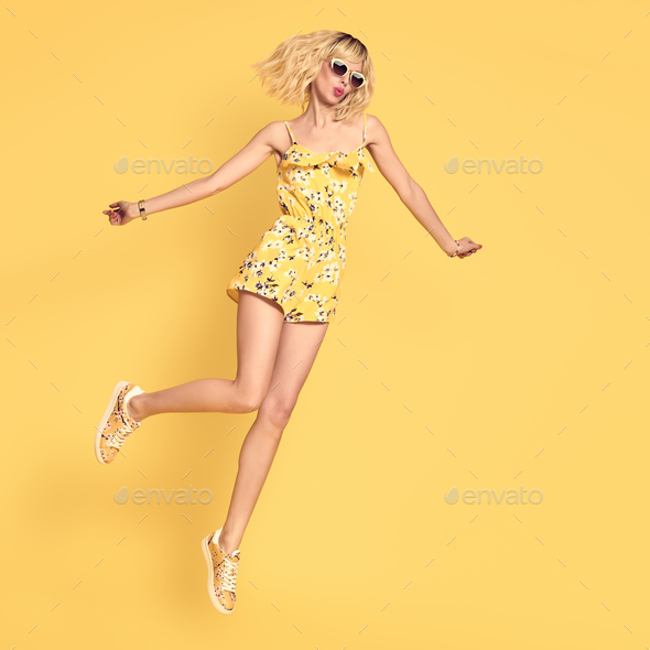 Happy girl Jumping, Fashion Sunglasses. Having Fun - Stock Photo - Images