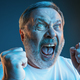 The senior emotional angry man screaming on blue studio background - PhotoDune Item for Sale