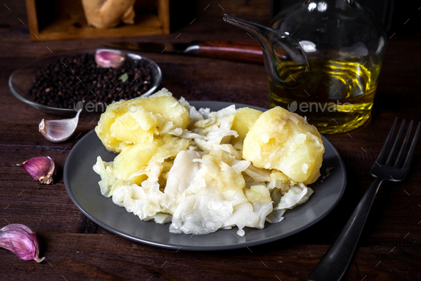 Homemade cabbage stew with potatoes on rustic wood stage - Stock Photo - Images