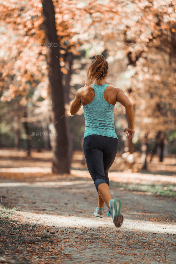 Woman Jogging Outdoors in The Fall - Stock Photo - Images