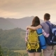 Young Couple of Travelers Looking Forward To the Horizon and Mountains - VideoHive Item for Sale