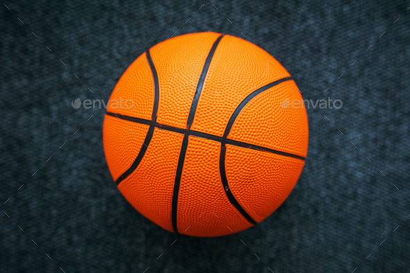 Basketball ball on dark surface - Stock Photo - Images