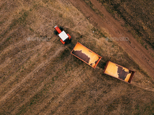 Aerial view of agricultural tractor in the field - Stock Photo - Images