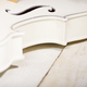 Close view of a violin on white wooden table - PhotoDune Item for Sale