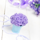 Violet flowers in blue metal bucket on white wooden table - PhotoDune Item for Sale
