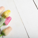 Fresh tulips on white wooden table with copy-space high angle vi - PhotoDune Item for Sale