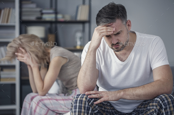 Tension between distant married couple - Stock Photo - Images