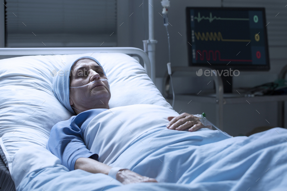 Middle-aged woman with cancer dying - Stock Photo - Images