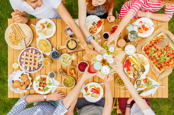 People toasting at table - Stock Photo - Images