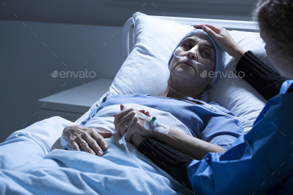 Daughter supporting dying woman - Stock Photo - Images
